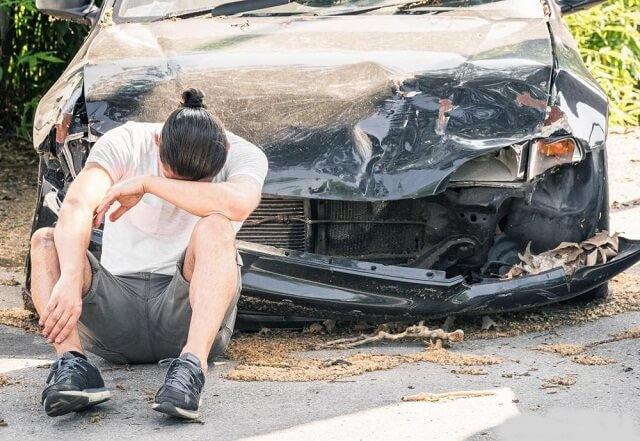 a person with a damaged car